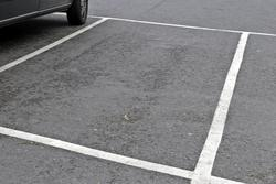 Foto av parkeringsplass.
